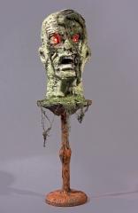 Zombie Halloweendekoration abgetrennter Kopf mit Leuchtaugen